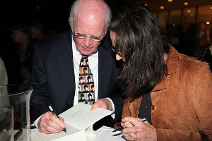 Taylor Branch signs a guest's copy of The Clinton Tapes