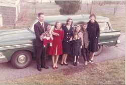 Carjacked authors Catherine Lutz (in red) and Anne Lutz Fernandez (with their father) in front of the family Ford.