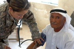 U.S. Army Pfc. Thornton takes the blood pressure of a local farmer during medical operations in Hor Al Bosh, Iraq, July 15, 2007. Thornton is a medic with the 115th Brigade Support Battalion out of Camp Taji. (U.S. Army photo by Sgt. Rachel M. Ahner)