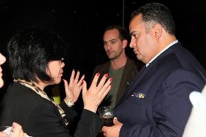 John Pérez talks to a guest