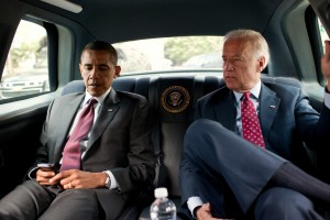 President Barack Obama and Vice President Joe Biden ride in the motorcade from the White House to the Ronald Reagan Building in Washington, D.C., July 21, 2010, to sign the Dodd-Frank Wall Street Reform and Consumer Protection Act.  (Official White House Photo by Pete Souza)