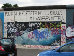 A Berlin mural bearing Carl von Clausewitz's famous dictum that war is a continuation of policy by other means.