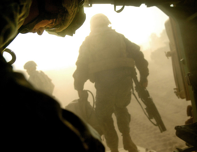U.S. Army Spc. Jeffery Moore prepares to exit a Bradley fighting vehicle on Camp Ar Ramadi, Iraq, following a raid in the Tameem district of Ramadi, Iraq, Sept. 3, 2006. Moore is with Bravo Company, 2nd Battalion, 6th Infantry Regiment, 1st Armored Division based out of Baumholder, Germany. (U.S. Air Force photo by Tech. Sgt. Jeremy T. Lock) (Released)