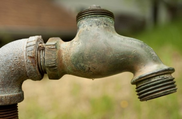 Rusty Old Pipe And Spigot