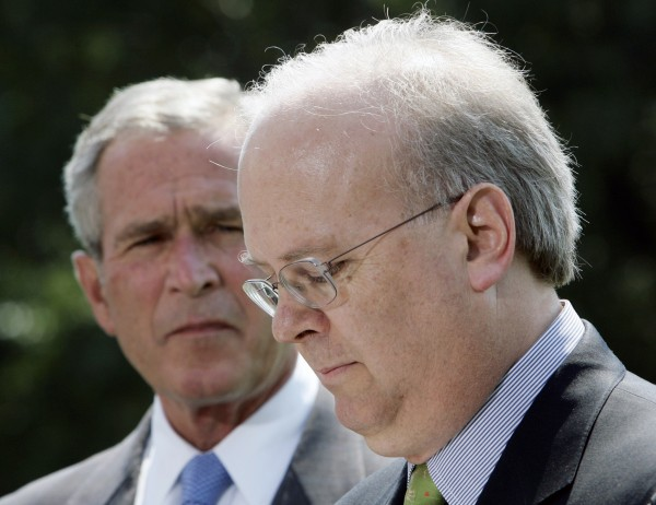White House Deputy Chief of Staff Karl Rove pauses as he announces his resignation beside U.S. President George W. Bush at the White House in Washington