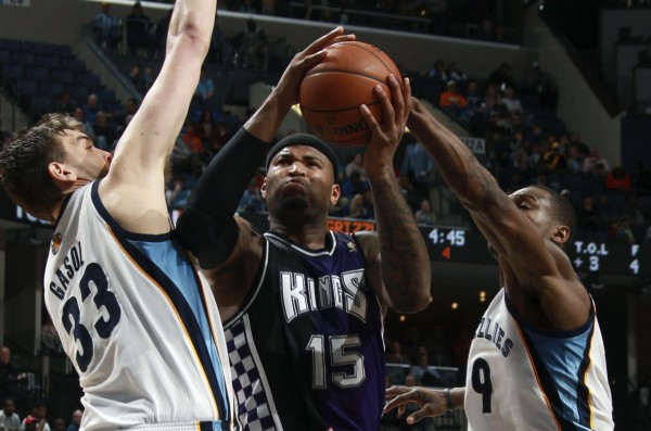 Sacramento Kings Cousins shoots defended by Memphis Grizzlies Gasol and Allen during their NBA action in Memphis
