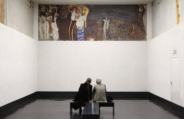 Visitors watch Gustav Klimt's Beethoven Frieze at the Secession museum in Vienna