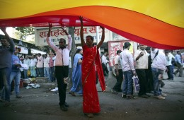 Participants hold a rainbow flag during Queer Azaadi parade, an event promoting gay, lesbian, bisexual and transgender rights in Mumbai