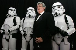 Star Wars creator George Lucas (2nd-R) poses with Storm Troopers, characters in the Star Wars movies..