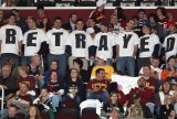 Cleveland Cavaliers fans in Ohio wear shirts expressing their disappointment towards LeBron James, who was with the Cavaliers for seven years before leaving to play for the Miami Heat