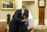 U.S. President Obama hugs Dallas nurse Pham at the Oval Office in Washington