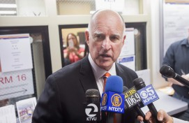 California Governor Brown speaks with reporters after casting his ballot at the Alameda County Registrar of Voters office in Oakland