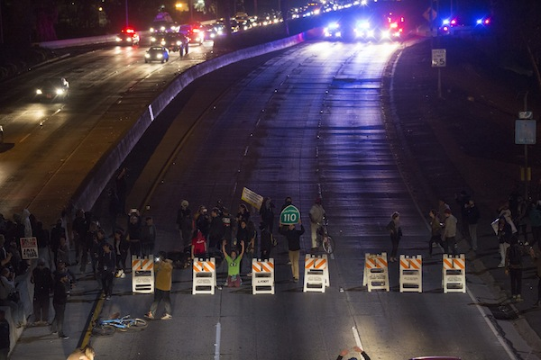 Protesters block the 101 freeway in Los Angeles, California