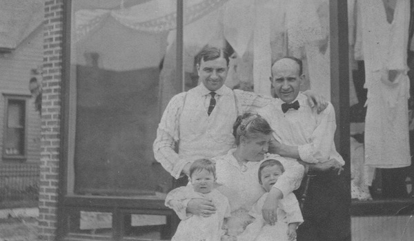 My paternal grandfather owned a dry goods and grocery store in Chicago. The babies are my father & his twin with store employees in 1915.