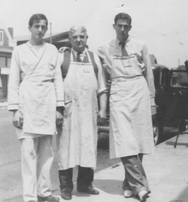 My father grew up working in his father's stores. Here he is with my grandfather and uncle, dressed for work, about 1934.