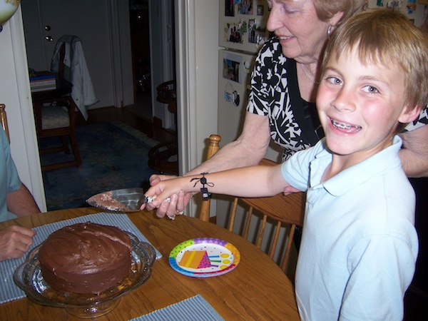 The author's brother and grandma cutting cake at her grandma's house about eight years ago.
