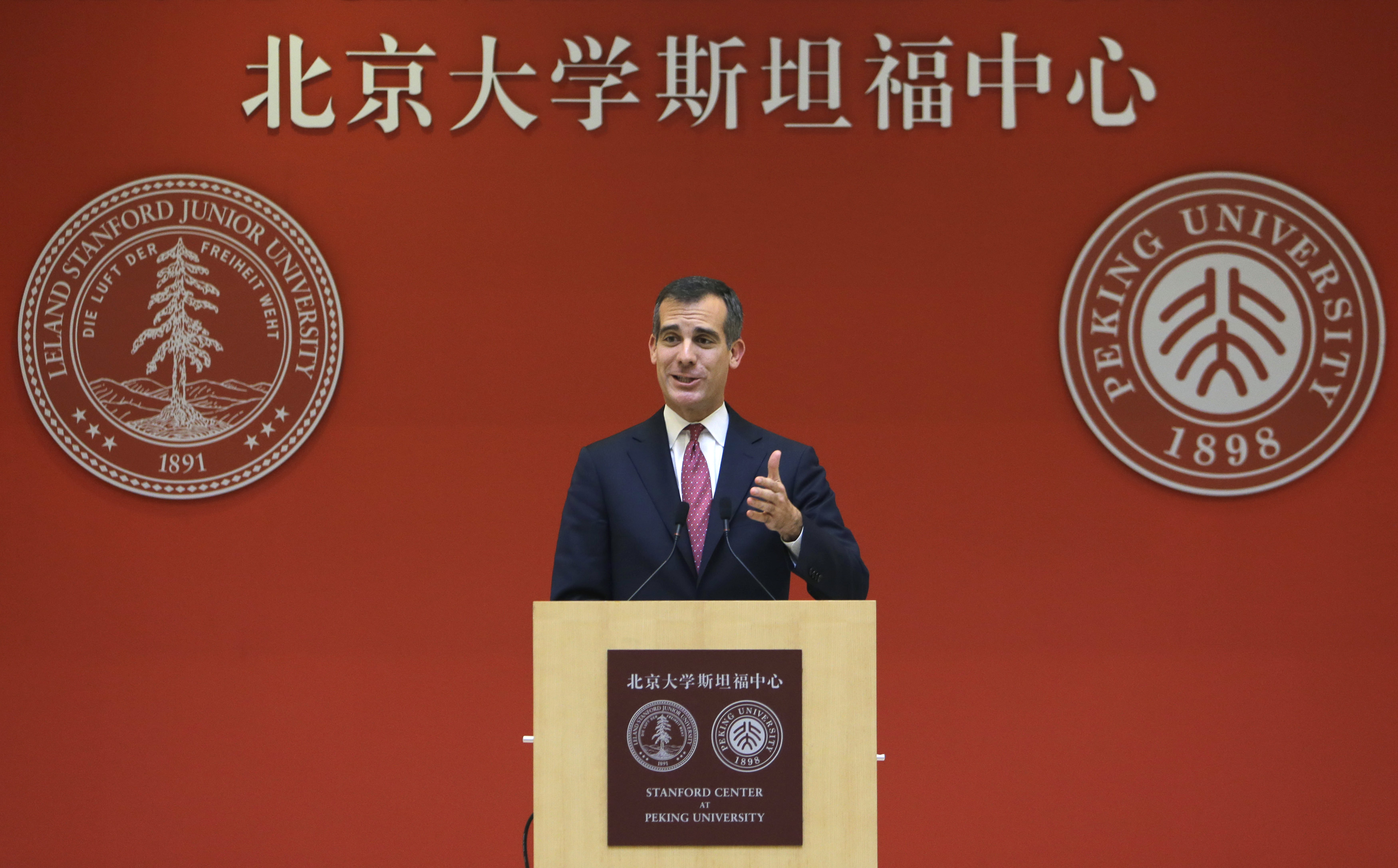 Los Angeles Mayor Eric Garcetti speaks during a conference on the challenges and opportunities for sustainable development in Beijing