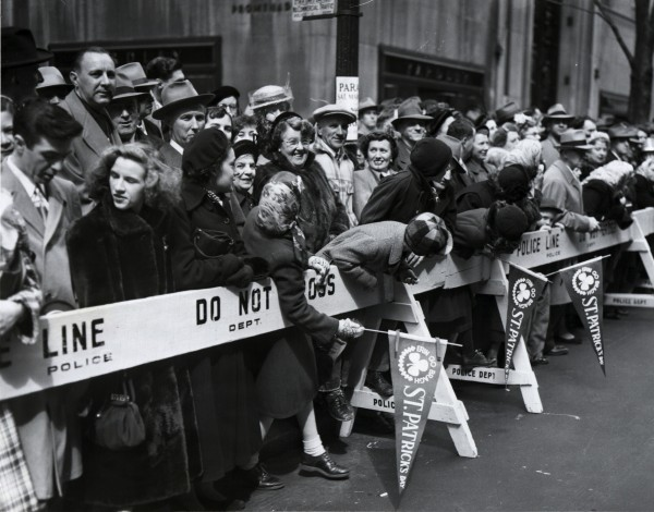 A crowd at the police barricades, waiting for the St. Patrick's Day Parade in New York City, 1951