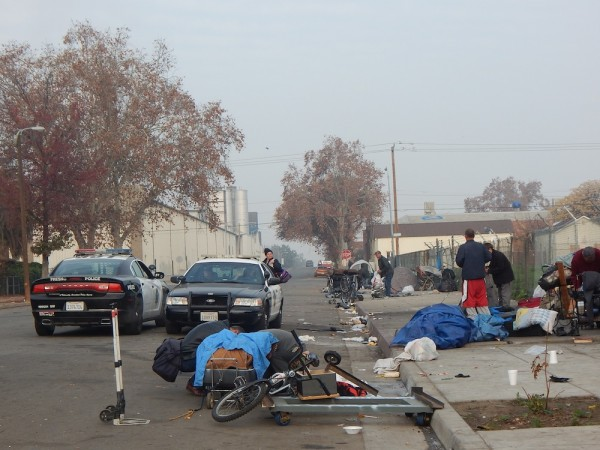 Since encampments were banned in Fresno, tents cannot be permanent. In the morning, police make sure those whose who spent the night on the streets pack everything up.