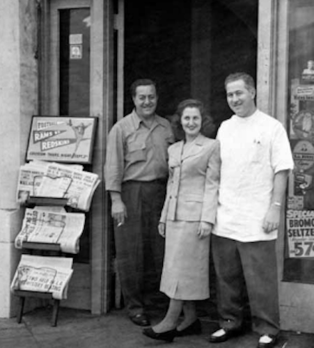 The Litvak family in front of the pharmacy in 1950