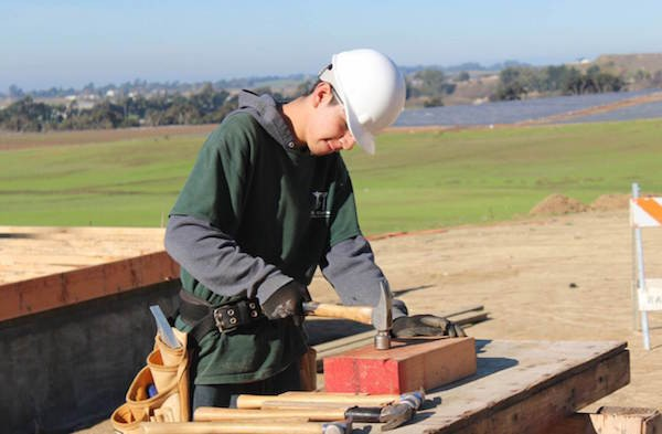 Daniel Lopez builds Transitional Houses on campus as part of the Construction Academy.