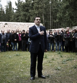 Greece's newly-appointed Prime Minister Alexis Tsipras places his hand on his heart during a ceremony at the Kessariani shooting range site where hundreds of members of the Greek Resistance were executed by Nazi occupation forces during World War II in Athens, January 26, 2015. Tsipras laid flowers at the monument following a swearing-in ceremony as Greece's first leftist Prime Minister. REUTERS/Alkis Konstantinidis (GREECE - Tags: POLITICS ELECTIONS TPX IMAGES OF THE DAY) - RTR4MZIU