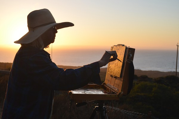 The author painting by the ocean