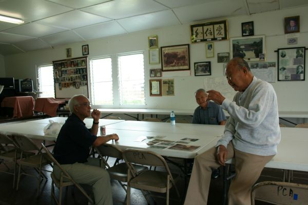 Talking Story with elders in the Piihonua Kaikan (community center) on the former Piihonua Sugar Plantation, Hawaii.