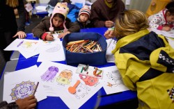 Migrant children colour in a playroom in a refugee camp in Celle, Lower-Saxony, Germany October 15, 2015. With the approach of winter, authorities are scrambling to find warm places to stay for the thousands of refugees streaming into Germany every day. In desperation, they have turned to sports halls, youth hostels and empty office buildings. But as these options dry up, tent cities have become the fall-back plan: despite falling temperatures, a survey by German newspaper Die Welt showed at least 42,000 refugees were still living in tents. Picture taken October 15, 2015. To match Insight EUROPE-MIGRANTS/GERMANY-WINTER REUTERS/Fabian Bimmer      TPX IMAGES OF THE DAY      - RTS4YGX