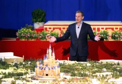 Chairman and CEO of The Walt Disney Company Bob Iger speaks in front of the unveiled scale model of the future Shanghai Disneyland during a news conference, in Shanghai, July 15, 2015. REUTERS/China Daily CHINA OUT. NO COMMERCIAL OR EDITORIAL SALES IN CHINA   - RTX1KBF6