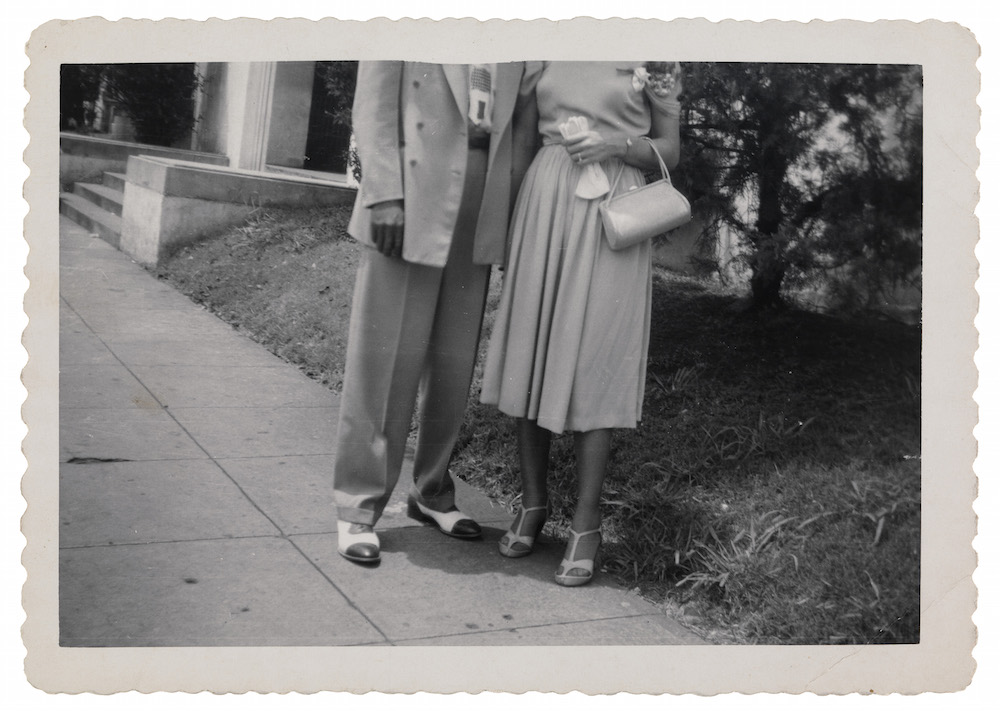 Man and woman posed on sidewalk with heads cropped Unidentified artist (American, 20th century) Photograph, gelatin silver print * Gift of Peter J. Cohen * Courtesy Museum of Fine Arts, Boston