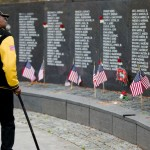 Vietnam veteran Charles Palmer pays his respects at the Vietnam Veterans Memorial on Veterans Day, Wednesday, Nov. 11, 2015, in Philadelphia. (AP Photo/Matt Rourke)