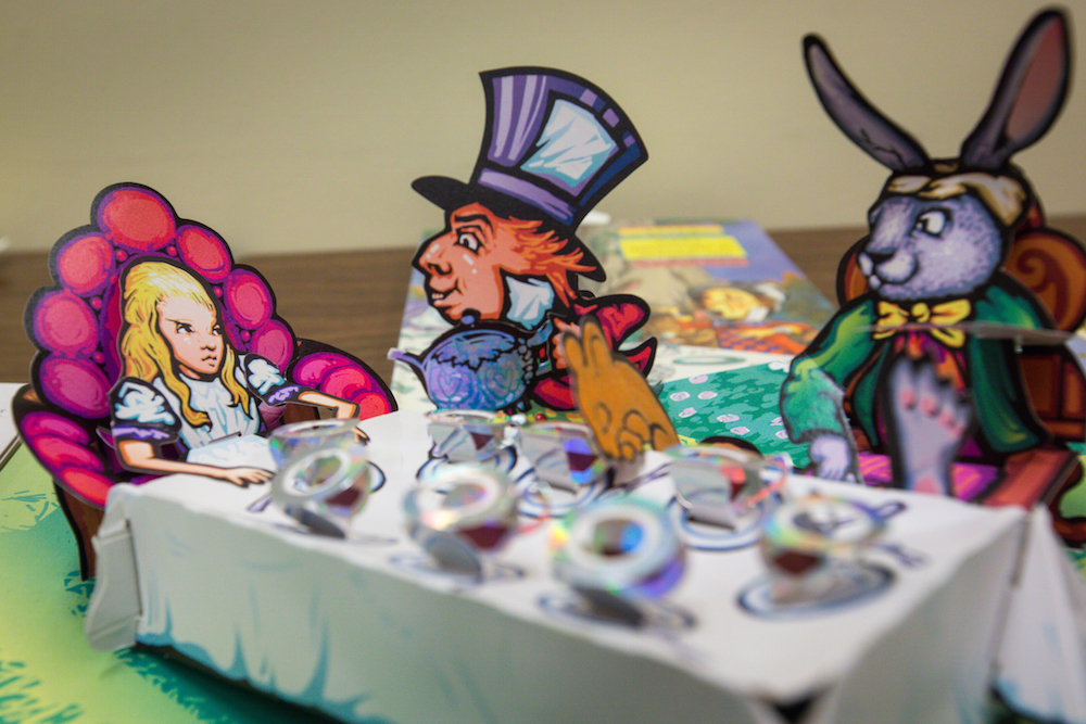 Tempe - July 28, 2015 - ASU News - Down the Rabbit Hole - There are several pop-up books including this scene from the Mad Tea Party,  from Alice's Adventures in  Wonderland by Robert Sabuda, in Hayden Library's collection of Lewis Carroll's Alice's Adventures in Wonderland and its sequel Through the Looking-Glass, on Wednesday, July 29, 2015. The library has an extensive collection that is available to the public for viewing. Photo by Charlie Leight/ASU News