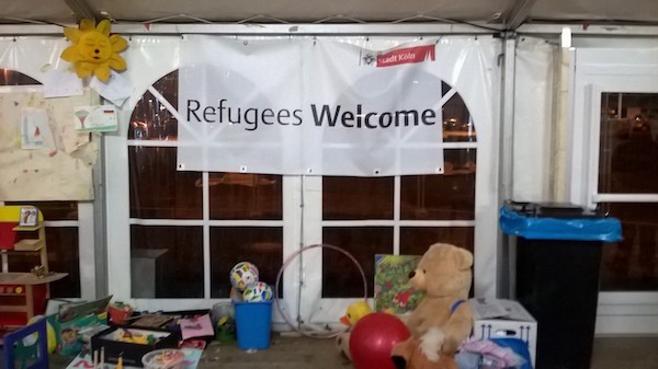 A humanitarian tent greets refugees to Cologne.