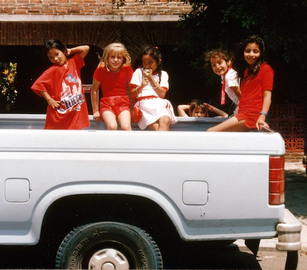The author's daughter Heather and her neighborhood pals heading to day camp in the author's truck.