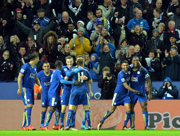 Leicester City Football Club players celebrate after striker Jamie Vardy scores an opening goal against Premier League powerhouse Chelsea Football Club.