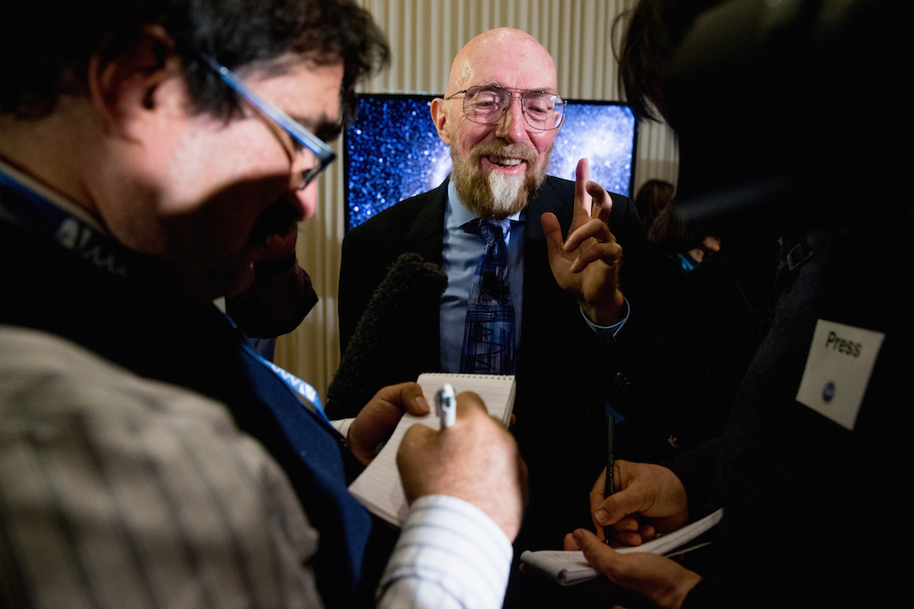 Laser Interferometer Gravitational-Wave Observatory (LIGO) Co-Founder Kip Thorne speaks to members of the media following a news conference at the National Press Club in Washington, Thursday, Feb. 11, 2016, as it is announced that scientists they have finally detected gravitational waves, the ripples in the fabric of space-time that Einstein predicted a century ago. The announcement has electrified the world of astronomy, and some have likened the breakthrough to the moment Galileo took up a telescope to look at the planets. (AP Photo/Andrew Harnik)