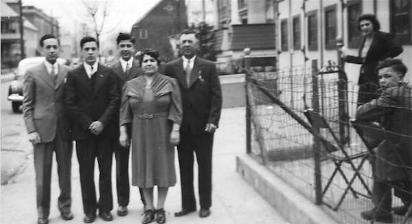The author's father (third from the left), standing behind his mother and with other members of his family in 1941.