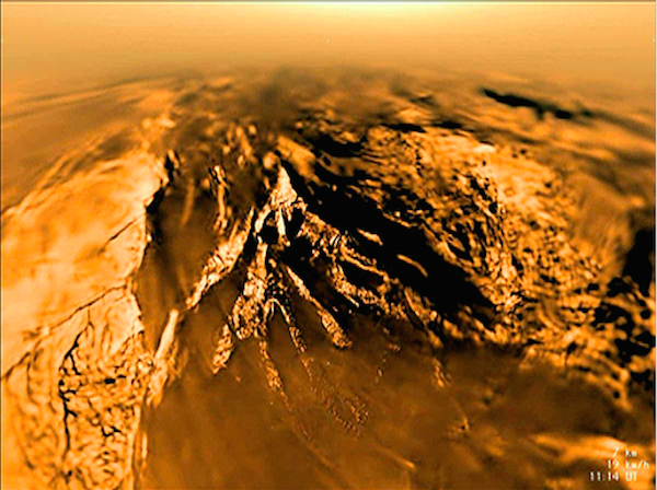The Huygens probe captured this image of Titan's landscape as it descended through the moon's atmosphere.