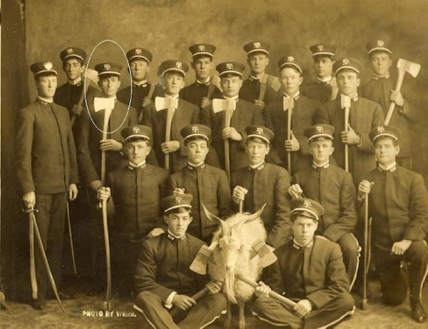 A group photo of Woodmen of the World with their goat mascot