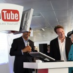 Britain's Queen Elizabeth II  uses a computer to upload a video to the Royal Channel on You Tube video alongside co-founder of You Tube Chad Hurley, centre , and President of Google Europe, Middle East and Africa Nikesh Arora , during a visit to the company British headquarters in London  Thursday Oct. 16, 2008. (AP Photo/Adrian Dennis, Pool)
