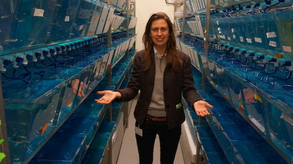 Olivia Osborne stands in the UCLA basement that houses the thousands of zebrafish she studies.