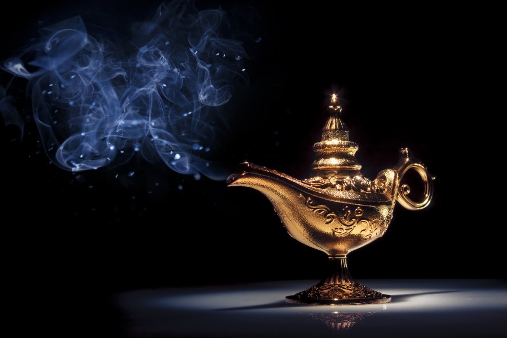 Magic Aladdin's Genie lamp on black with smoke
