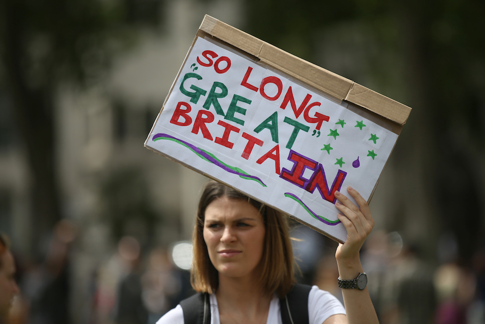 Demonstrators opposing Britain's exit from the European Union in Parliament Square following yesterday's EU referendum result, London, Saturday, June 25, 2016. Britain voted to leave the European Union after a bitterly divisive referendum campaign. (AP Photo/Tim Ireland)