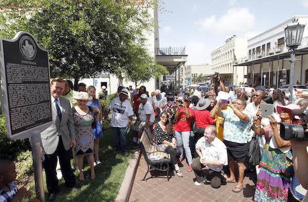 The crowd gathers for photos of the Juneteenth historical marker in Galveston, Texas in 2014. It was placed at the site of where the Osterman Building, the Union Army headquarters, once stood.