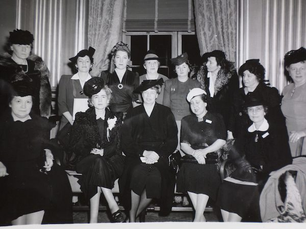 "Eleanor Roosevelt, center, acting as assistant director of civilian defense, at a 1941 conference on ""women's activities in civilian defense."""