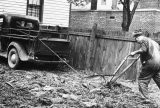 Tony Garcci of Richmond, Va., determined to plant a Victory Garden despite the shortages of farmhands and horsepower, works the plow being pulled by his pickup truck, driven by Joe Garcci, April 1, 1943.  The job was completed in a few hours' time.  (AP Photo)