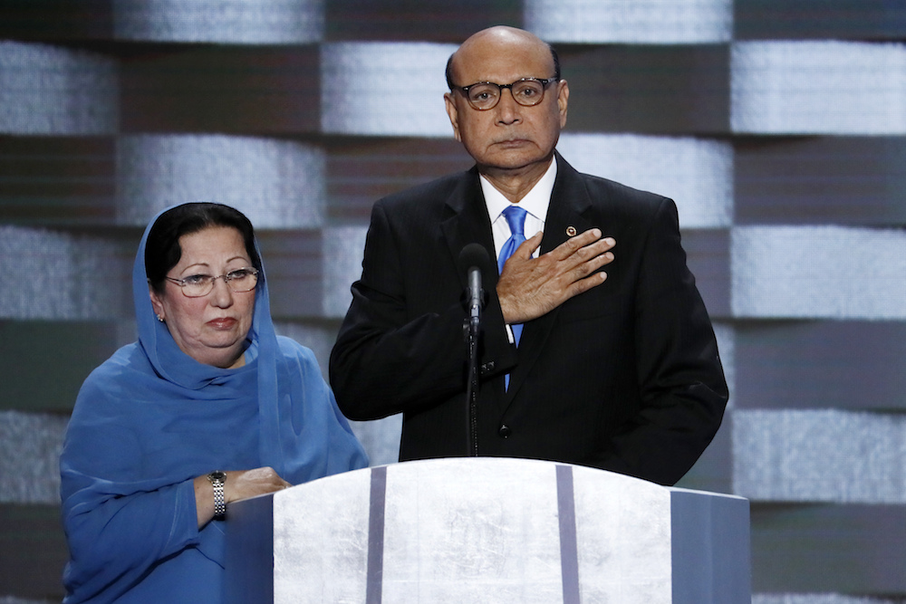 Khizr Khan, father of fallen US Army Capt. Humayun S. M. Khan and his wife Ghazala speak during the final day of the Democratic National Convention in Philadelphia , Thursday, July 28, 2016. (AP Photo/J. Scott Applewhite)