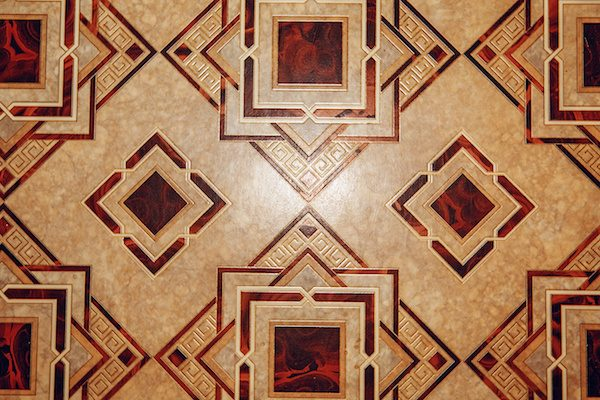 Linoleum floor with brown geometric pattern.