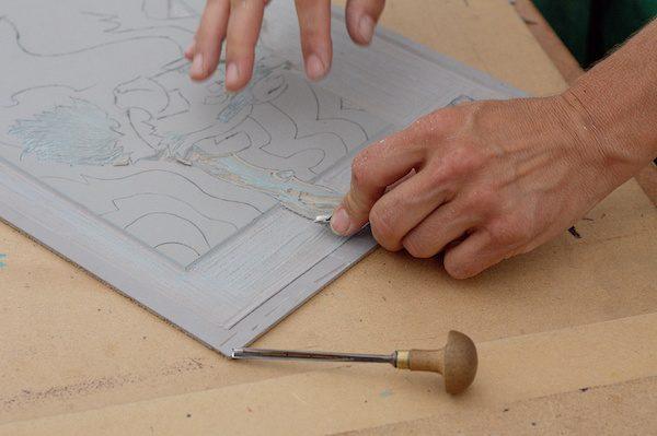 Preparing a linocut design.